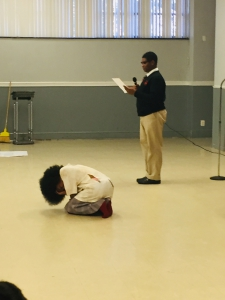 Students perform a story on child labor